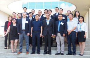 Dr. Krishna Udayakumar (Director, Duke GHIC) and Dr. Robert Eick (Former Policy Fellow, Duke-Margolis), and members of the China NHSA delegation outside the Duke Fuqua School of Business at Duke University in Durham, NC.